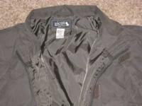 mens size Medium, GICOS brand dark green rain jacket.