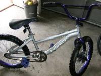 Purple wheels handle bars and pedals text or call