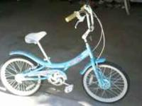 Available for sale is a girl's 20 inch bike in good