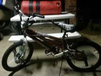 20 inch mongoose bike. Its brown and white. Like new,