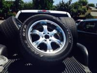 20 inch 6 lug rims and used tires asking 200 obo.