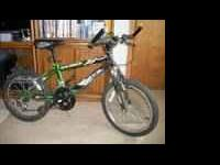 "FOR SALE: 20"" Green & Black 18 speed Mountain Bike."