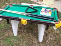 I have for sale a miniature pool table with balls,