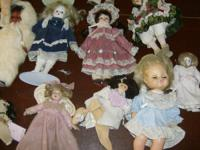 Have 20 collectable porcelain and soft face dolls from