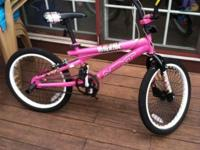 I have a Pretty Pink Next Bike White Rims, Black