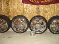 "I have a set of 20"" chrome rims. The are 5 spoke and in"
