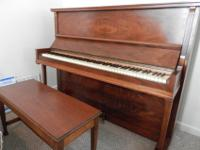 This is a nice upright piano and is in good condition.