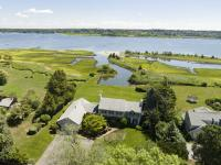 Location is everything! This Waterfront Colonial