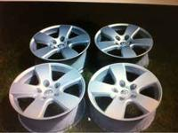 I have a set of 4 factory 20 X 8 Dodge Ram wheels in