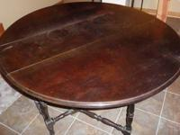 Our gate leg table stands about 30 inches high. With