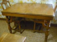 This is a cute antique kitchen/dining room table that