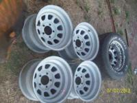 A complete set of five on 5 Diamond Racing wheels for