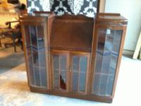 Solid wood antique secretary desk with book shelves.