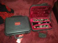 it is a selmer Bb clarinet and comes with 2 mouthpieces