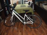 White GIANT brand women's hybrid road bike. Slightly