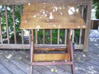 This is a vintage drafting table in good condition. The