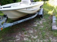 I am offering my 2000 14 ft scout center console with