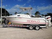 This 2000 24' Robalo Walkaround is powered by Twin