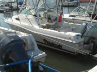 24 ft wellcraft walkaround, has a factory hardtop, full