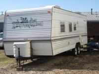 This camper can be seen in Moline, It is a 2000 27'