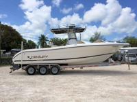 This 2000 28' Century 2800 Center Console is powered by