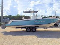 This 2000 30' Contender 27 Open Center Console is
