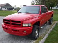 2000 4x4 Red Dodge 2500 Ext. Cab Long Bed 4 door 8L V10