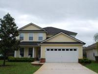 This wonderful five bedroom, three bath home sits on a