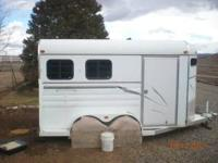 2000 American 2 Horse slant bumper pull. Model is 14