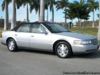 This 2000 Cadillac Seville is silver with a black top.