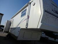 """JUST REDUCED"" 2000 CEDAR CREEK 5TH WHEEL/W 3 SLIDE"