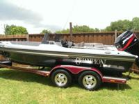 2000 champion fish hunter bass boat with a 2002 Mercury
