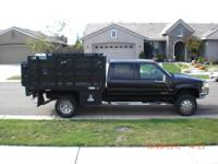 1 ton chevy flat bed 4x4 Dualy 4 door crew cab flat bed