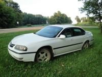 2000 white Chevy Impala with 3800 engine. Runs and