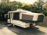You are looking at a 2000 Coleman pop-up camper. it