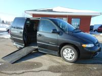 This Is a very nice Dodge Grand Caravan with the Rollx