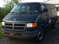 Custom 2000 Dodge Ram Van. Cloth interior, captain
