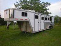 Used, 2000, 4 Horse Featherlite is in good condition.