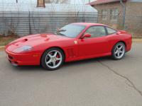It has Maranello Floormats, a Rosso/Tay interior with