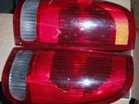selling both stock tail lights replaced with