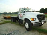 2000 Ford F650 flatbed, 75% rubber, very good