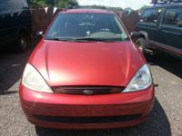 This is a red 2000 Ford focus. Checked just in July.
