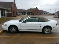 2000 Ford Mustang Convertible. 153K miles. White with a