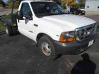 This 2000 Ford Super Duty F-350 Regular Cab flat bed