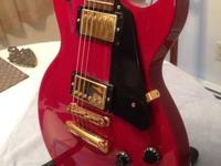 Offering my wine-red 2000 Gibson Les Paul Studio and