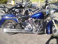 The studded seat and saddlebags are vintage Harley. It