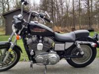 For sale is a 2000 Harley Davidson Sportster 1200. Bike