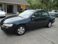 Options Included: Alloy Wheels, Moonroof, Child Seat,