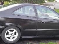 Listed are a 2000 Honda DX coupe and a 99 Honda LX