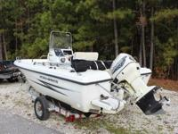 This Lovely Boat Includes: Galvanized Trailer 115 HP